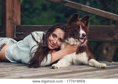 Young woman with her border collie dog. concept about animals and people