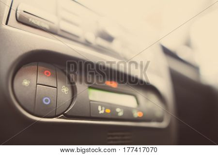 Close up image of a car's air conditioning panel.