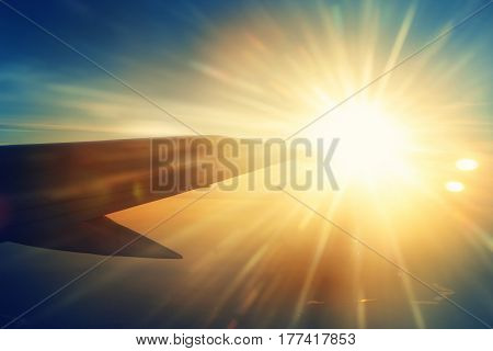Airplane Wing And Beautiful Sun Beams
