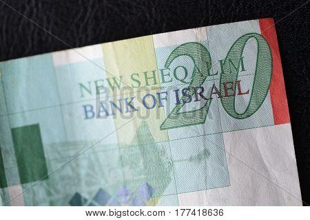 Twenty Israeli Shekels On A Dark Background