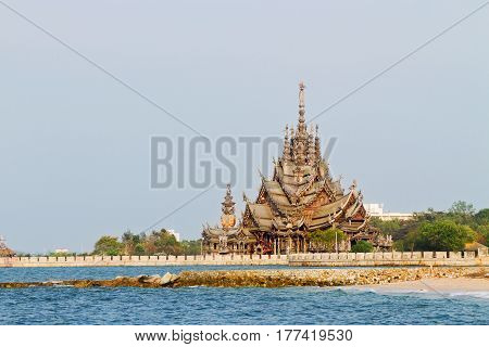 Sanctuary of Truth all-wood building filled with sculptures based on traditional Buddhist and Hindu motives. Pattaya Thailand. View from sea.
