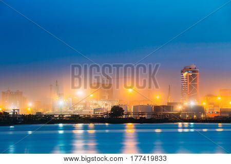 Batumi, Adjara, Georgia. Port Dock On Sunny Evening Or Night At Illuminations Lights