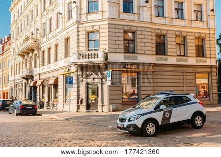 Riga, Latvia - July 1, 2016: Road Police Car in Parking On Jekaba Street In Old Town In Sunny Summer Day