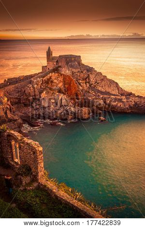 View of the gothic church of St. Peter at sunset in Porto Venere Liguria region Italy.