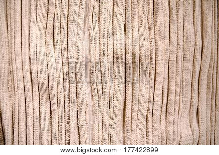 the gathered natural beige linen textile background.