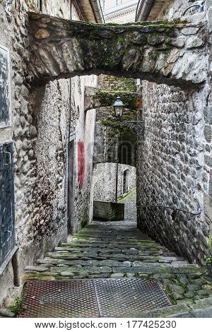 Old alleyway in ancient town Villafranca Italy.