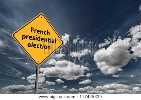 Background of dark blue sky with cumulus clouds and yellow road sign with text French Presidential Election