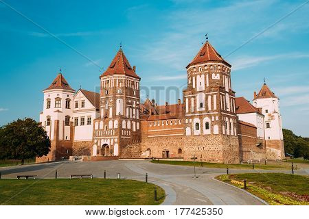 Mir, Belarus. Scenic View Of Old Towers Of Mir Castle Complex On Blue Sunny Sunset Sky Background. Architectural Ensemble Of Feudalism, Cultural Monument, UNESCO Heritage. Famous Landmark In Summer