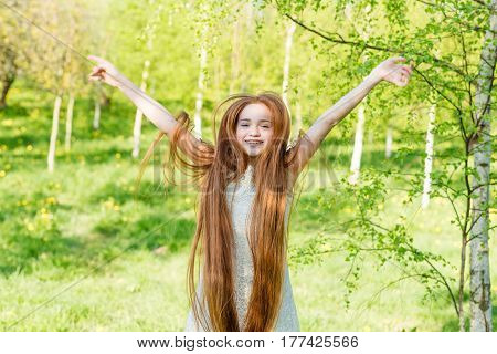 Beautiful Redhead Girl With Long Hair In A Park With Dandelions