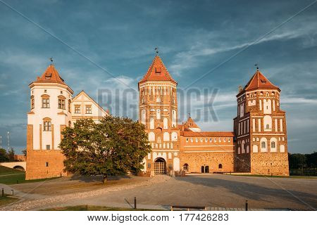 Mir, Belarus. Mir Castle Complex On Blue Sunny Sunset Sky Background. Architectural Ensemble Of Feudalism, Cultural Monument, UNESCO Heritage. Famous Landmark In Summer