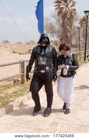 Participants Of Festival Dressed As Darth Vader And Princess Leia