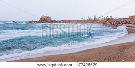 Small storm on the Mediterranean Sea on the promenade of Caesarea in the old town in Israel