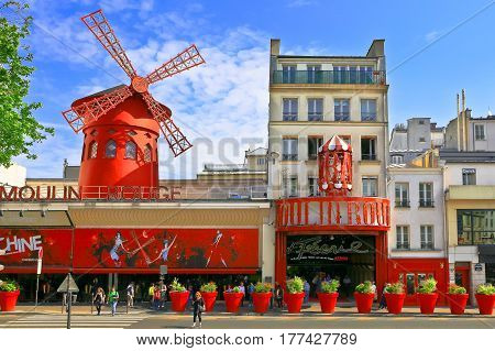 PARIS - MAY 28, 2016: Moulin Rouge. Moulin Rouge is a famous Parisian cabaret built in 1889, located in red-light district of Pigalle on Boulevard de Clichy.
