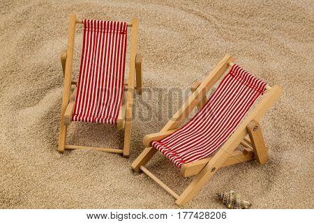 deckchair on sandy beach