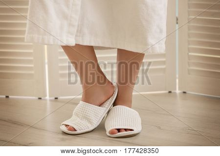 Legs of beautiful young woman in spa salon