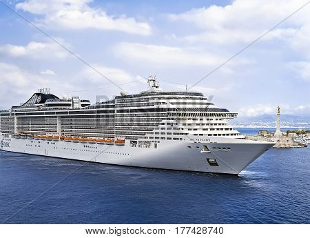 MESSINA, SICILY, ITALY - MAY 05, 2011: MSC Fantasia cruise ship sailing to port. MSC Fantasia is the largest cruise ship ever built for a European ship owner.