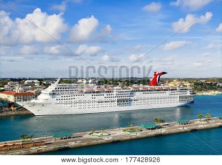 NASSAU, BAHSMAS - APRIL 15, 2015: The Carnival Cruise Ship Fascination in port of Nassau, Bahamas.  Nassau is one of the most popular cruise port destinations in the Caribbean.