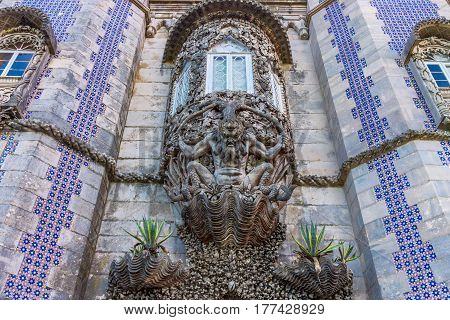 Carved stone figure of a sea monster in a wall at the Palacio da Pena, Sintra, Portugal. Pena National Palace the oldest palace inspired by European Romanticism. UNESCO World Heritage Site