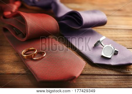 Wedding rings and cuff-links on ties, closeup