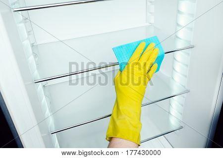 Man's Hand Washing Refrigerator Inside