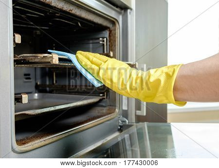 Man With Rag Cleaning Kitchen Stove