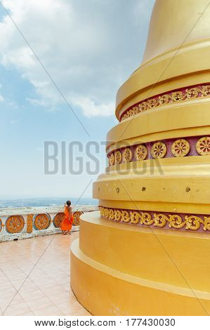 KRABI THAILAND - APRIL 10: Novice monk observes the hilltop of the Tiger Cave Mountain Temple on April 10 2016 in Krabi Thailand.