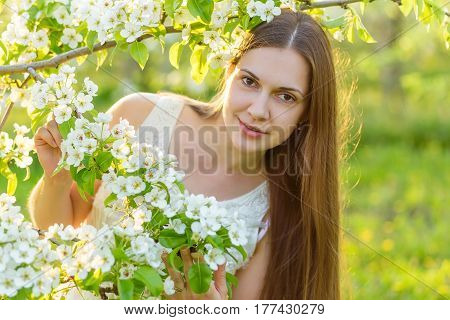 Portrait Of A Beautiful Young Woman In The Rays Of The Setting Sun