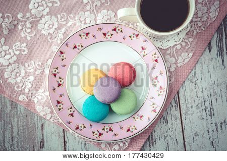 Multicolored Macaroon Cookies And Coffe