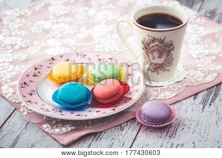 Macaroon Cookies On Plate On Wooden Gray Table