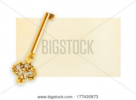 Retro key on paper card isolated on white background