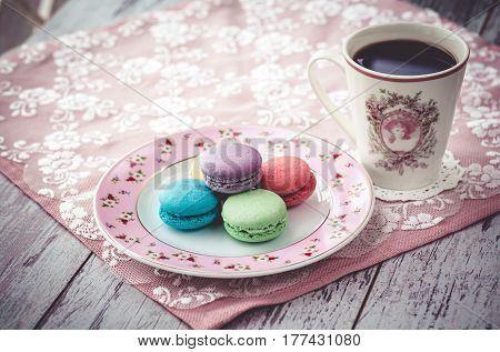 Macaroon Cookies On Plate And Coffe