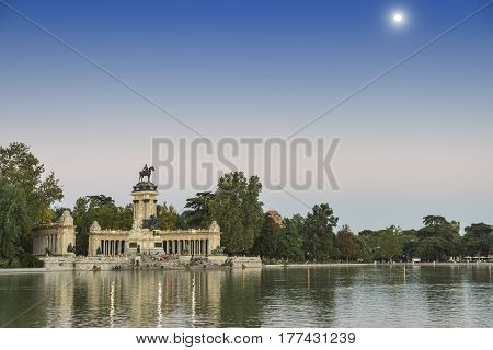 MADRID, SPAIN - JULY 17, 2016: Madrid (Spain): the Park of Buen Retiro at evening. Palace and lake