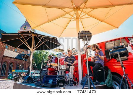 Riga, Latvia - July 1, 2016: Street Musicians Buskers Permorming Songs Near Cafe On The Dome Square In Sunny Summer Day With Blue Sky