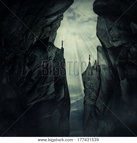 Conceptual image with two lost persons standing on the edge of different mount peaks trying to find each other. Life search and discover symbol.