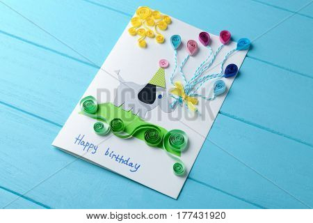Fancy gift card on blue wooden background