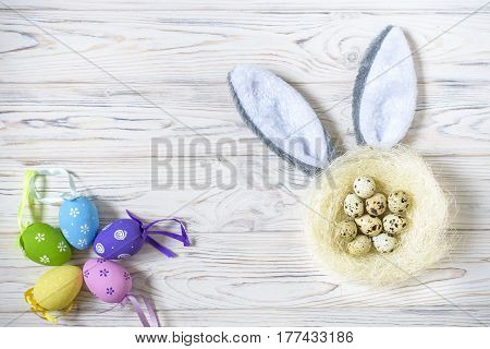 A Nest With Colored Easter Eggs And Bunny Ears At Home On Easter