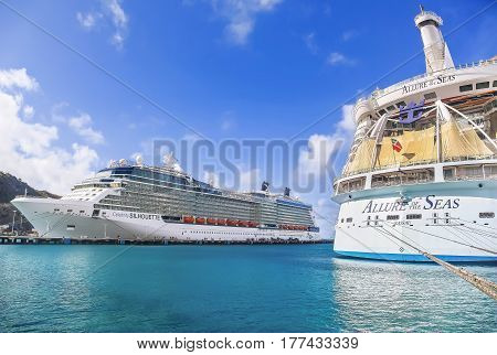 PHILIPSBURG, ST. MARTEEN - APRIL 16,2015: Cruise ships Celebrity Silhouette and Allure of the Seas, docked at Philipsburg, St. Marteen harbor on a sunny day.