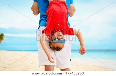 father and happy little son playing at sky