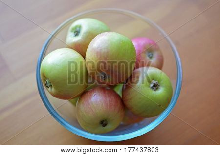 Red-green Small Apples In A Glass Bowl