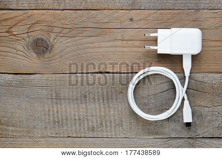 Charger for smartphone or tablet on wooden table
