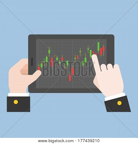 business hand tab on tablet screen with candle stick of market stock, making money online from forex or trading concept, flat design