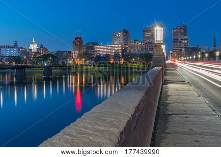 Harrisburg Pennsylvania night skyline from the Market Street bridge with state capitol .
