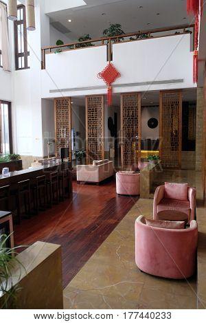 JIAXING, CHINA - FEBRUARY 21: Lounge bar interior, Yuehe Hotel, Nanhu Qu, Jiaxing Shi, Zhejiang Sheng, on February 21, 2016 in Jiaxing, China.