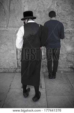 JERUSALEM, ISRAEL - MARCH 06, 2017: Hasidim (orthodox Jews) pray at the Western Wall in the old city