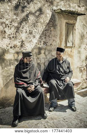 JERUSALEM, ISRAEL - MARCH 06, 2017: Ethiopian priests at the wall of the Church of the Holy Sepulcher in the Old City