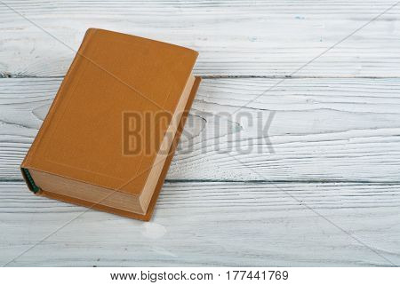 Open hardback book on wooden table. natural background . Back to school. Copy space for text