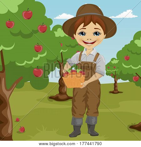 farmer little boy picking apples holding basket standing in orchard smiling