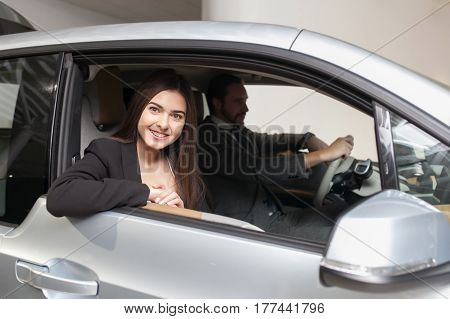 attractive couple chooses the car in the showroom