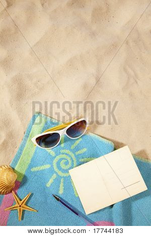 beach items  and a blank vintage postcard with copy-space