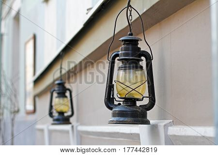 Beautiful street lamps hanging on facade of building in city